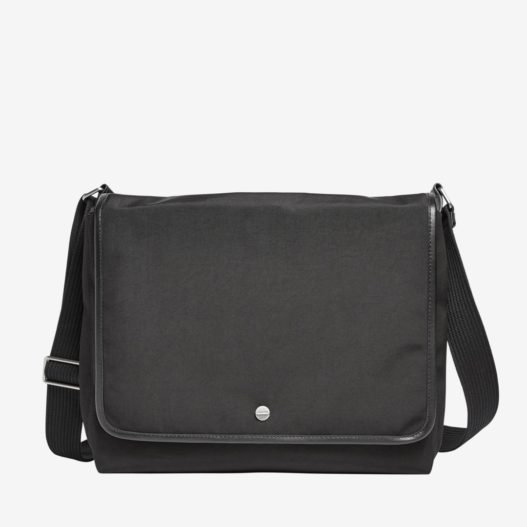 The Eric messenger can be worn comfortably by the adjustable shoulder strap or carried by the grab handle. Two external side zip pockets and a slip pocket on the back provide easily accessible storage. The interior includes a zip pocket, slide pocket, pen holder and padded sleeve for a 13-inch laptop.